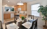 view of the kitchen/dining area in one of the apartments at Village at Blue Hen