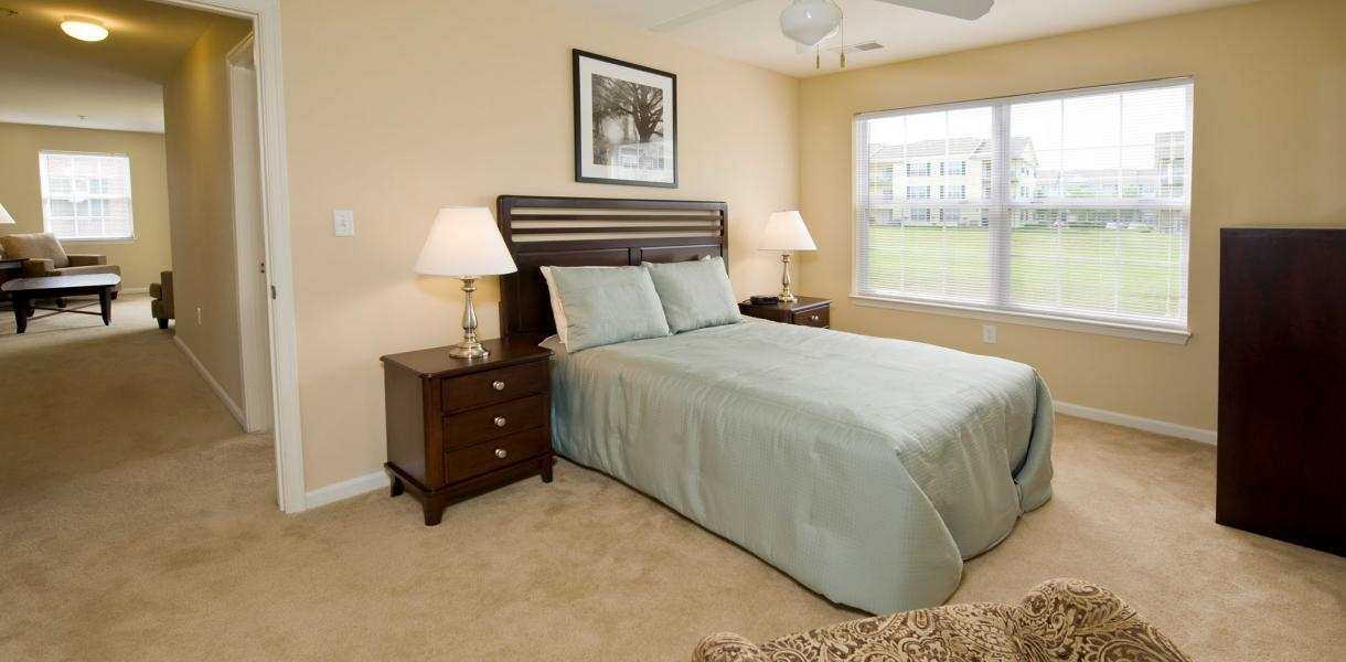 a bedroom featuring a ceiling fan at Rockwood Apartments