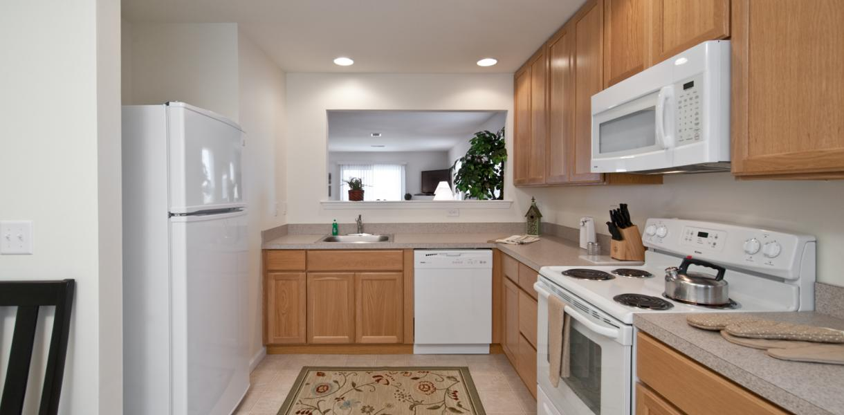 View of a kitchen within an apartment at the Village at Blue Hen