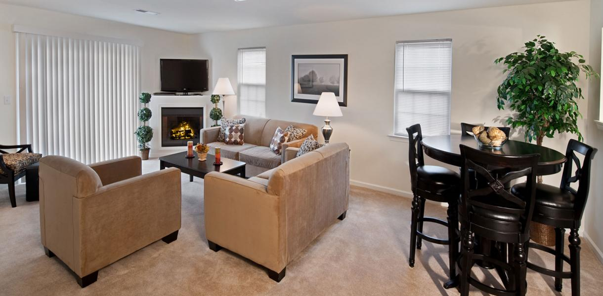 View of a living room within an apartment at the Village at Blue Hen