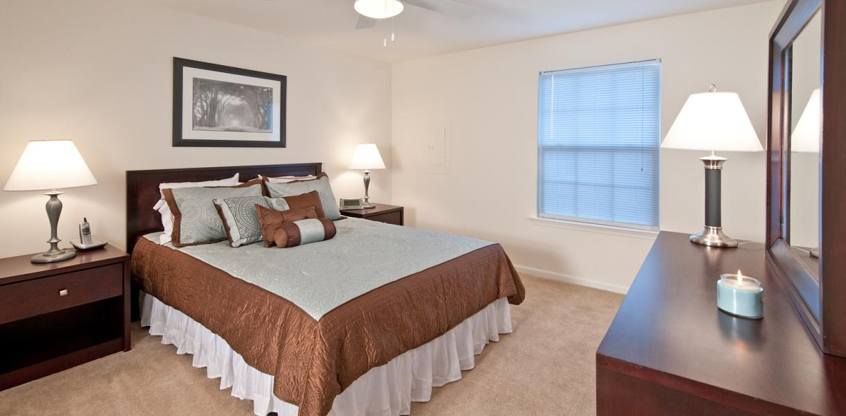a bedroom within one of the apartments at West Creek Village