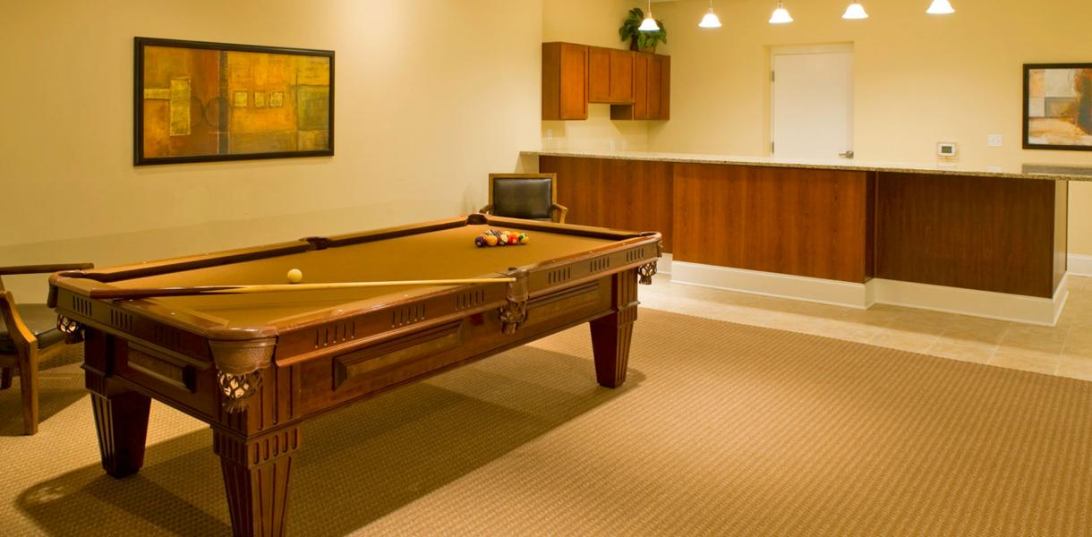 view of the pool table at the community center at the Towers at Greenville