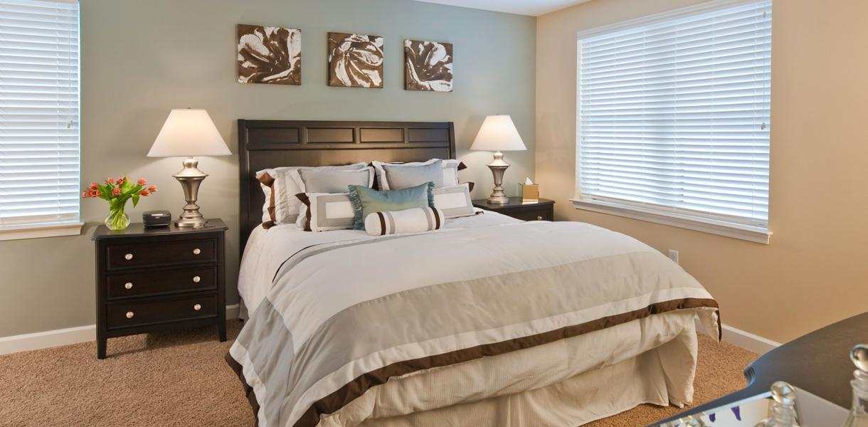 view of a bedroom within one of the apartments at Towers at Greenville