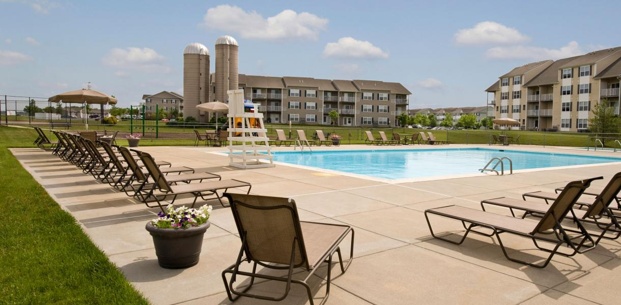 view of the pool with Rockwood Apartments in the background