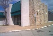 Image of the old strip mall featuring stone walls